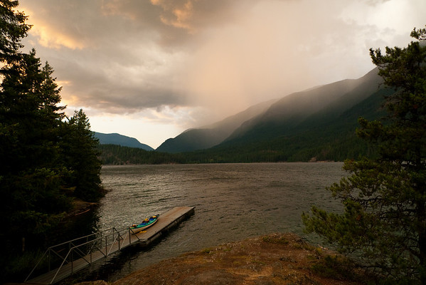 Storms move in as the sun sets over Cougar Island